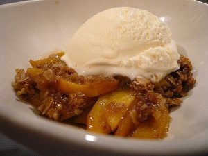 peach cobbler with a scoop of vanilla ice cream